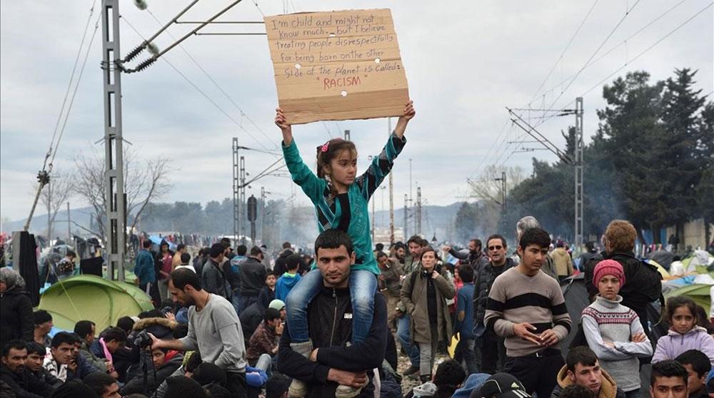 Manifestación de refugiados en el campo de Idomeni | Foto: AFP / Daniel Mihailescu